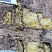 Signs hidden under exterior siding walls/windows...